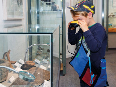 Boy looking at the archeology display