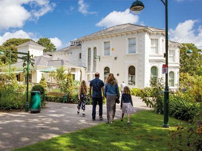 Family walking towards Penlee House Gallery & Museum
